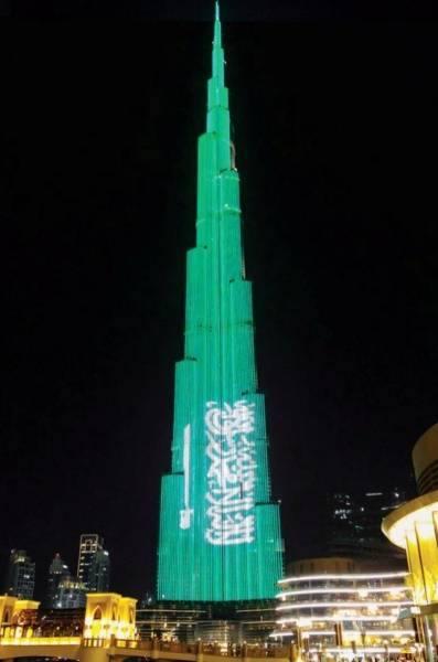 الإمارات تتوشّح بالأخضر مشاركة المملكة احتفالها باليوم الوطني