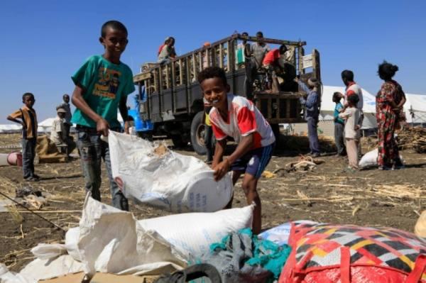 لاجئون أثيوبيون فروا من صراع تيغراي في مخيم شرق السودان (أ ف ب)