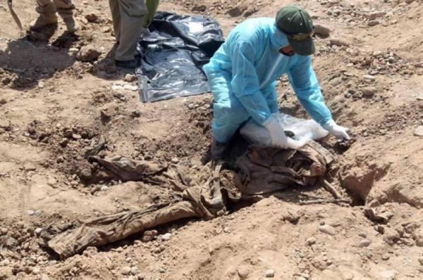 فتح مقبرة جماعية في العراق لتحديد هويات 123 شخصا