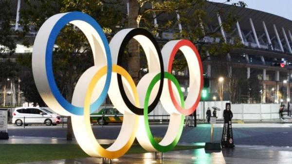 إنجلترا ترفع القيود وشبح كوفيد يخيم على الأولمبياد